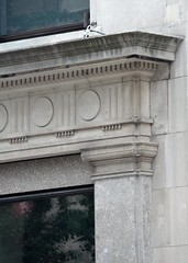 NYC_Fifth_055_004 (TNoble2008) Tags: 1911 architectrobertmaynicke archtectmaynickeandfranke capital capitalpilaster doorsurround entablature materialstone medallion ornament ornamentdentils ornamentguttae pilaster styleclassical styledoric styledoricdenticulated typecommercial typecommercialloft typeurban