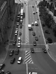 City Street with Traffic in Barcelona (Image Catalog) Tags: barcelona road street trees blackandwhite cars spain automobile traffic outdoor pedestrians intersection publicdomain barcelonaspain