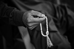 with hope.. (camelot98.) Tags: leica travel bw white man black monochrome 50mm asia dof hand candid islam faith religion rangefinder manual karachi rosarybeads m9 tasbih