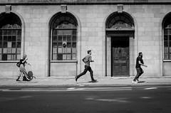 Wednesday noon (lilyshot) Tags: runningfigures running walkingonphone noon noondaysun