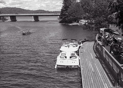 Mooring in Front of the Trading Bay Dining Company (Bill Smith1) Tags: billsmithsphotography canonf1n dorseton fdn50f14lens hc110b ilforddelta100 july2016 lakeofbays muskoka filmshooterscollective