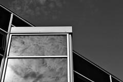 Black and White Glass (DaveJC90) Tags: suffolk felixstowe town sea seaside water wave waves beach stone rock summer warm hot walk walking afternoon sun sunny sunlight light bright sky blue cloud dark shadow view landscape black white blackandwhite bw colour colours crop croped nikon d5100 digital slr camera wide angle zoom lens 1020mm 1855mm pier building old new classic modern metal glass detail sharp sharpness