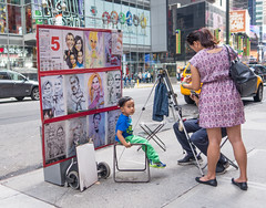 Sitting For His Portrait (UrbanphotoZ) Tags: nyc newyorkcity boy ny newyork sitting manhattan broadway mother posing midtown timessquare westside mm mmworld characatures characaturist