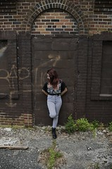 (Emily Ciaccio) Tags: flowers roses building brick abandoned nature girl fence vines grafitti