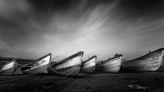 Stationed (kevinkishore) Tags: boats longexposure stationed bank shore river clouds cloudscape nd filter black mono white outdoor light ground background backwaters