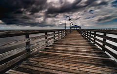 Goodbye Blue Sky (fuzzy_dunlop_nola) Tags: nx500 weather pier louisiana samsungnx samsung longexposure vantage view fishing samsungnx1224mmf456 southlouisiana outdoor sunsetpoint mandeville mandevillelouisiana no drab murky landscape dark clouded gloomy scape storm light fishingpier 1224mm wideanglezoom nx wideangle mirrorless sky clouds cloudy nx1224mmf456 dim neutraldensity ndfilter samsungnx500 wide bwfilter bw nd 10stop bw110