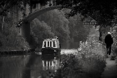 Just passing - Canal travel Black and white of the trent and Mersey canal with both forms of travel (Matt Burke) Tags: blackandwhite man water boat canal canalboat