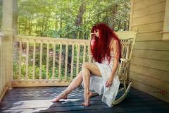 Summer Reveries (Spoken in Red) Tags: womanportrait barefeet sundress whitedress longredhair porch summerportrait rockingchair woods trees leaves shadows sunshine afternoonlight spokeninred