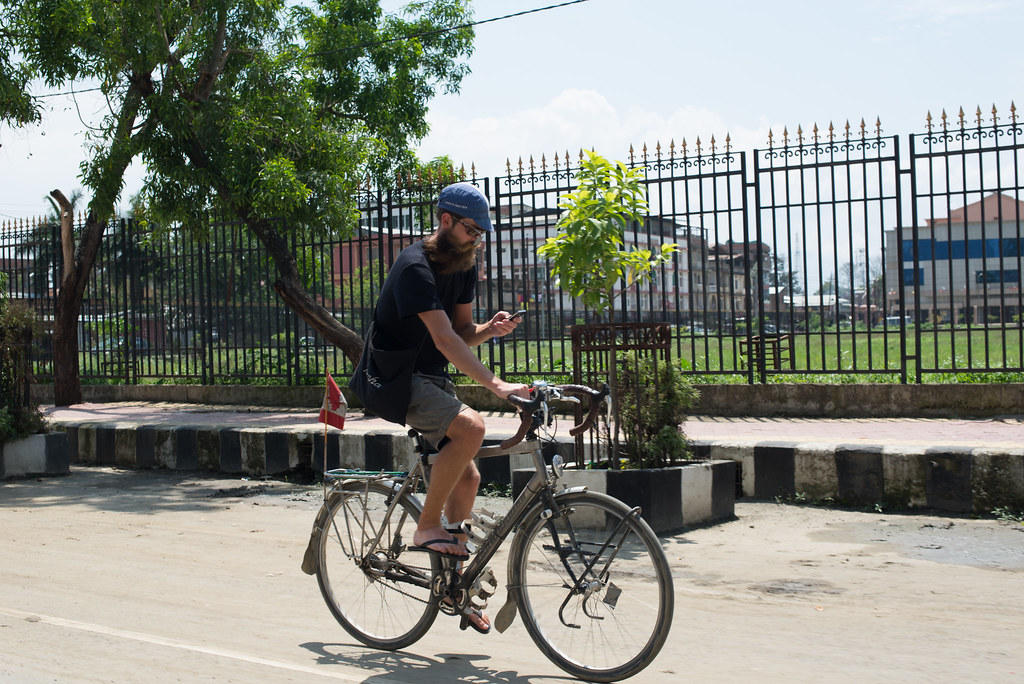 Hipster Dre cycling the streets of Imphal