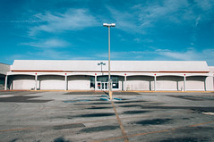 Tampa (J. Parker Natural Florida Photographer) Tags: street city sky urban color building abandoned clouds tampa store parkinglot closed raw cityscape tampabay florida outdoor empty bluesky departmentstore storefront kmart lightroom centralflorida hillsboroughcounty vsco vscofilm