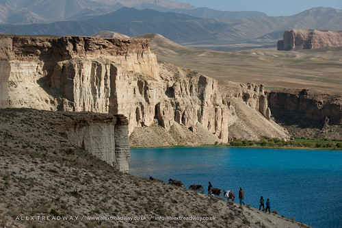 Donkeys and farmers make their way home along the lakeshore of Band-e Amir