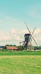 .Hello neighbour :P (i  e R t i aN e v e r f a r) Tags: holland clouds windmills dayout
