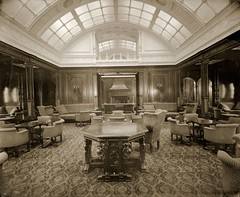 1st class smoking room on RMS Mauretania (Tyne & Wear Archives & Museums) Tags: abstract blur industry wall architecture table carpet lights design interesting construction chair fireplace pattern candle shine floor post unitedkingdom furniture timber interior empty room ships famous decoration progress grand vessel social ceiling historic unusual wealthy elegant shipyard decor society cushion tyneside luxury development firstclass impressive important wealth fascinating digitalimage status oceanliner luxurious meetingplace rivertyne shipbuilding wallsend launched industrialheritage c1907 smokingroom upperclass northeastengland passengership cunardline blackandwhitephotograph mauretania northeastofengland artanddesign shipbuildingheritage maritimeheritage swanhunterwighamrichardson rmsmauretania wallsendyard 20september1906 1stclasssmokingroom