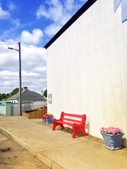 Broadford village (JulieK (moving house, very busy)) Tags: street flowers ireland wall bench village display colourful telegraphpole broadford limerick hbm beddingplants iphone5 distressedfxapp