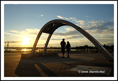 Seeing The Light Together 夕陽無限好- Oval SX5002e (Harris Hui (in search of light)) Tags: harrishui fujixt1 digitalmirrorlesscamera fuji fujifilm vancouver richmond bc canada vancouverdslrshooter mirrorless fujixambassador fujixcamera fujixseries fujix x70 fujix70 fujixcompactcamera sunset olympicoval oval seeingthelighttogether lastlight together togetherness silhouettes couple communityactivities goingoutdoor riverside river fraserriver sky clouds themoment catchthemoment romantic romanticmoment