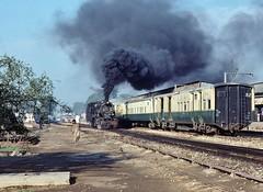 Pakistan Album  |  Mirpur Khas Junc  |  1990 (keithwilde152) Tags: yd523 mirpur khas junction sindh pakistan 1990 station pilot coaches track steam locomotives people smoke town outdoor sun