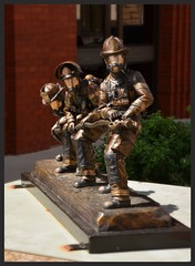 Advancing the line.... (Bubash) Tags: sculpture firemen bronze eau claire three brave wisconsin tour peoples choice vote favorite