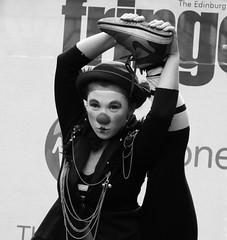 Fringe on the Mile 2016 0203 (byronv2) Tags: edinburgh edimbourg edinburghfestival fringe fringe2016 edinburghfestivalfringe edinburghfringe edinburghfringe2016 edinburghfestivalfringe2016 royalmile oldtown performer festival stage facepaint makeup music musician dance dancer acrobat clown blackandwhite blackwhite bw monochrome woman girl flexible dancing costume pretty sexy