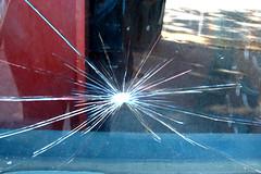 star-shaped glass break (lisafree54) Tags: glass break broken cracks cracked star starlike starshaped background design free freephotos cc0