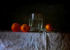 Three Apricots ... (MargoLuc) Tags: light summer stilllife orange texture water glass fruit dark table soft natural sweet july indoor days frutta apricots albicocche