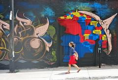 The girl with the red skirt (Alex L'aventurier,) Tags: montreal montral quebec qubec art urbain urban murale graffiti colors colour couleurs wall mur candid woman femme fille girl skirt jupe dress walking marcher mouvement movement stride street rue city ville
