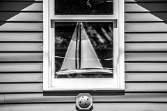 sailboat in the window (-gregg-) Tags: sailboat window display reflection bw lines shadows