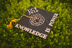 Knowledge is Power (Michael Mendonca) Tags: summer 2016 ucf graduationphotos universityofcentralflorida florida hot orlando outside july august people place thing nikkor sigma sun ring fire pegasus bokeh elegant dress white whitedress trees tree nature branch bridge boardwalk cap gown girl brenizer