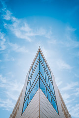 The Glass Tower on Downer Avenue (ScottNorrisPhoto) Tags: architecture minimal minimalist color blursky clouds glass tower abstract structure windows vertical symmetry symmetrical bright clear sunny outdoors miwaukee eastside downeravenue bold geometric saturated concrete corner angled point triangle spire 365project explore photography photooftheday photoaday scottnorrisphotography milwaukee wisconsin usa
