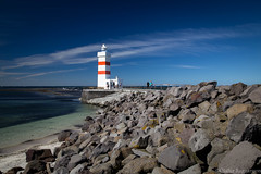 The lighthouse (.Gu) Tags: viti lighthouse shore fjara iceland icelandic sland gu ogud olafurragnarsson lafurragnarsson garskagaviti stone stones steinar steinn fjrusteinar