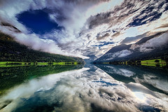 Morning reflections II (Usstan) Tags: autumn oppstrynvatnet d750 nikon calm serene water mountains outdoor lake clouds norway seasons locations wideangle rocks colors stryn norge lens sigma sky 1224mm landscape sognogfjordane morning no