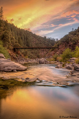 Sunset at Edwards Crossing (sierrasylvan) Tags: adobe adobebridgecc2015 adobelightroomcc2015 adobephotoshopcc2015 bridge edwardscrossingbridge canon canonefs1585mmf3556isusmlens canoneos50d filter hoya hoyahdcircularpolarizingfilter foothills sierranevadafoothills mountains sierrarange sierranevadamountains photomatixpro5 california nevadacounty tahoenationalforest plants river yubariver southyubariver edwardscrossing trees tripod manfrotto manfrotto190xprobtripod manfrottobasicpantilthead vivitar vivitarwirelessshutterreleasevivrc200 autumn black blue canyon cascade cascades clouds fall forest gray green hills landscape nature orange outdoor red reflection rocks shore silhouette sky sunset twilight water stream white yellow southyubariverrecreationarea