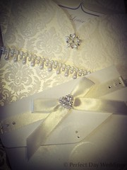 White elegance! Beautiful handmade pocketfold wedding invitation featuring satin ribbon, diamante heart, pearls, embossed card.  By bespoke wedding stationery specialist Perfect Day Weddings London. Discover more at www.perfectday-weddings.co.uk Call 0208 (Perfect Day Weddings) Tags: uk original wedding london classic beautiful modern vintage table sussex evening handmade wallet monogram lace contemporary unique marriage ascot richmond surrey best pearls retro invitation card windsor ribbon kensington weddings elegant pocket hampton mayfair stationery berkshire invite wimbledon luxury middlesex hounslow nottinghill invites invitations pockets weddinginvitations berks chiswick wallets twickenham rsvp esher luxurious greatgatsby bespoke customised personalised teddington custommade chequebook shabbychic tailormade pocketfold diamant handmadeweddinginvitation pocketweddinginvitation vintageweddinginvitation bookfold luxuryweddinginvitation bespokeweddinginvitation walletweddinginvitation weddinginvitationlondon londonweddinginvitation bookfoldweddinginvitationlondon