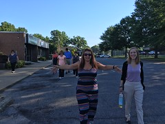 Holly and Laura have fun on an early morning group walk for wellness.