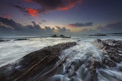 Tanjung Jara Dungun (Adly Wook) Tags: ocean longexposure trip travel red sea sky cloud seascape texture beach beautiful rock stone composition sunrise canon landscape photography seaside rocks stream flickr outdoor dramatic explore serene terengganu leefilter hdwallpaper rgnd sighray