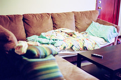 (deanmackayphoto) Tags: 50couchesin50nights couch contax film filmisnotdead 35mm losangeles longbeach bed sheets pillow door coffee table green remote blanket