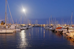 Loneliness at the port (Fnikos) Tags: port sea water waterfront boat night moon light moonlight reflection sky skyline serene architecture vehicle outdoor