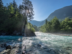 Smoke on the water (Ulmi81) Tags: olympus omd em1 918 mft june juni 2016 soca koritnica mouth bovec slovenia slovenien isonzo water clear blue mist wasser klar blau neben wasserdampf gegenlicht sonne sonnenstrahlen sun sunrays rays river fluss kajak kajaking wassersport tal valley sky himmel sonnenschein sunshine tree trees morning morgen natur nature light licht landscape landschaft