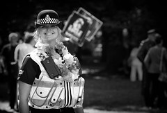 Pretty & The Garland (Just Ard) Tags: woman police officer southwales heddlu smile pretty garland people person face street photography candid unposed black white mono monochrome bw blackandwhite noiretblanc biancoenero schwarzundweis zwartwit blancoynegro  justard nikon d750 85mm depthoffield