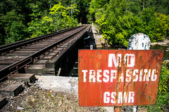 GSMR (marshallross) Tags: railway rail railyard bridge track traintrack traintracks train nature notrespassing gsmr smokymountains photography trees outdoor sunny rusty concrete sign rust old