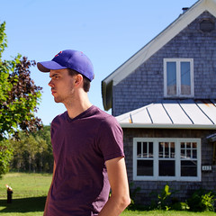 Erick and Farmhouse (Sean Anderson Media) Tags: summer portrait house architecture composition farmhouse 50mm farm f14 country profile oldhouse cubs doorcounty cubshat lensadapter nikon50mmf14 fotodiox nikontosonyemount sonyaa7rii