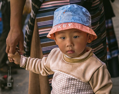 Tibet, candid shot of a kid in the streets of Lhasa (China), 06-2016, 07 (Vlad Meytin, vladsm.com) (Vlad Meytin | Instagram: vmwelt) Tags: pictures china street boy summer baby photography kid asia child candid traditional chinese streetphotography tibet clothes tibetan holdinghands local  lhasa    chengguan   khimporiumco meytin vladmeytin vladsm vladsmcom