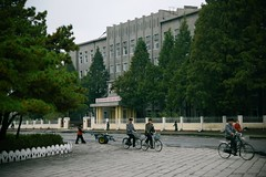 Street scene Wonsan (Frhtau) Tags: dprk north korea korean people leute street scene centre town daily life asia asian east nordkorea passers by passanten architecture propaganda wonsan main road strasse building gebude architektur design scenery   choxin  outdoor      corea del norte core du nord coreia do coria    culture landstrase stadt gebudekomplex public information billboard city fussgnger