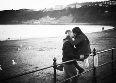 Couple kissing by the sea (matthewheptinstall) Tags: scarborough seaside love couple younglove kiss embrace beach moment affection sea ocean