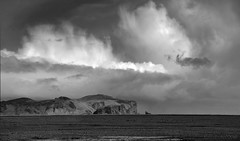 storm clouds over Vik (lunaryuna) Tags: ocean sky bw monochrome clouds blackwhite iceland cliffs vik coastline lunaryuna cloudscape northatlantic dyrholaey southiceland stormapproaching