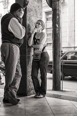 street talk (Gerard Koopen) Tags: cuba santaclara bw blackandwhite people woman man talking adidas streettalk straatfotografie streetphotography straat street candid fujifilm fuji x100t 2016 gerardkoopen