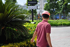 Someone else's hat (Roving I) Tags: sunhats wronghat fathers vicomcentre vietnam malls shopping danang signs advertising logos brands giordano ecco gardens trees greenery nature