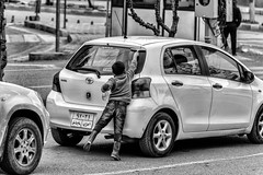 Window cleaner (Saman A. Ali) Tags: street streetphotography stphotografia blackwhite blackandwhite monochrome poor little boy life lifestyle streetlife documentary car outdoor vechile carwindow