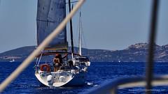 Cute Girl Helmsman (Sailor Alex) Tags: boat sailboat sloop vessel sardinia yachting cruising cruisers yacht sea sailing