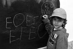 ermes (Roberto Gramignoli) Tags: ritratto ritratti persone lavagna scrivere segni bambino bambini blackandwite bw potrait child