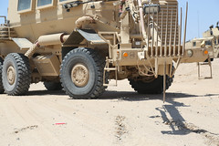 FORT IRWIN, Calif. -- U.S. Army Soldiers from the 16th Brigade Engineer Battalion use the robotic arm of a Buffalo Mine-Protected Clearance Vehicle to probe for a possible explosive device during Decisive Action Rotation 15-08 at the National Training Cen (Operations Group, National Training Center) Tags: usa calif fortirwin